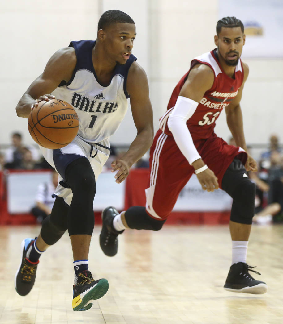 Dallas Mavericks' Dennis Smith Jr. (1) drives the ball past Miami Heat's Gian Clavell (53) during a basketball game at the NBA Summer League at the Cox Pavilion in Las Vegas on Tuesday, July 11, 2 ...