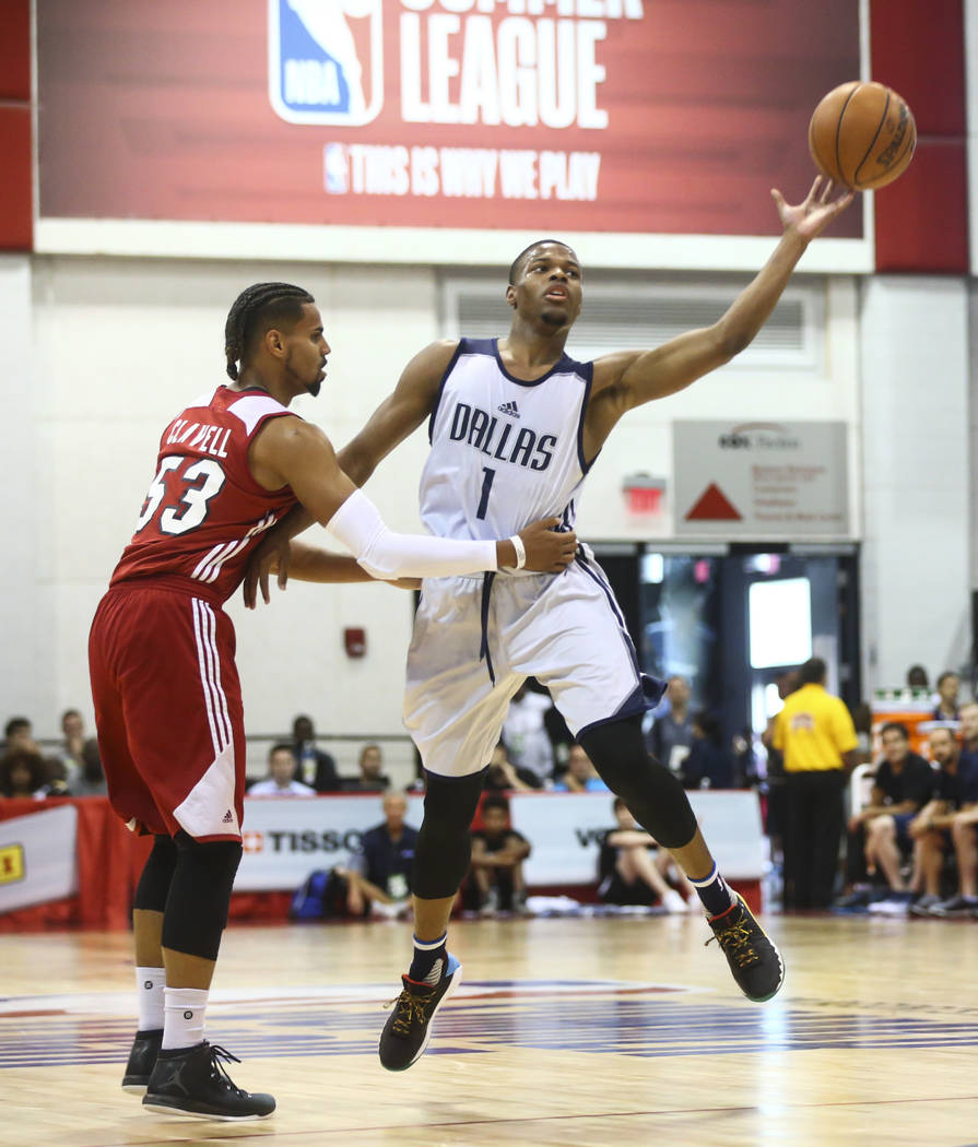 Dallas Mavericks' Dennis Smith Jr. (1) passes the ball as Miami Heat's Gian Clavell (53) defends during a basketball game at the NBA Summer League at the Cox Pavilion in Las Vegas on Tuesday, July ...