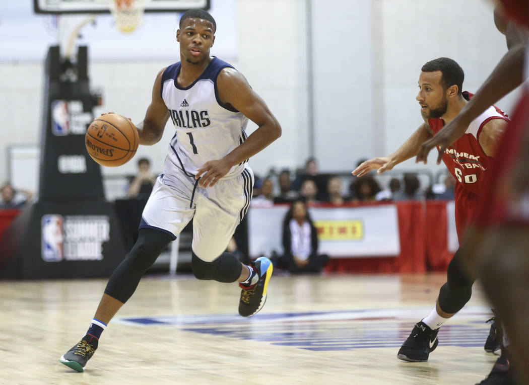Dallas Mavericks' Dennis Smith Jr. (1) drives to the basket against the Miami Heat during a basketball game at the NBA Summer League at the Cox Pavilion in Las Vegas on Tuesday, July 11, 2017. Cha ...