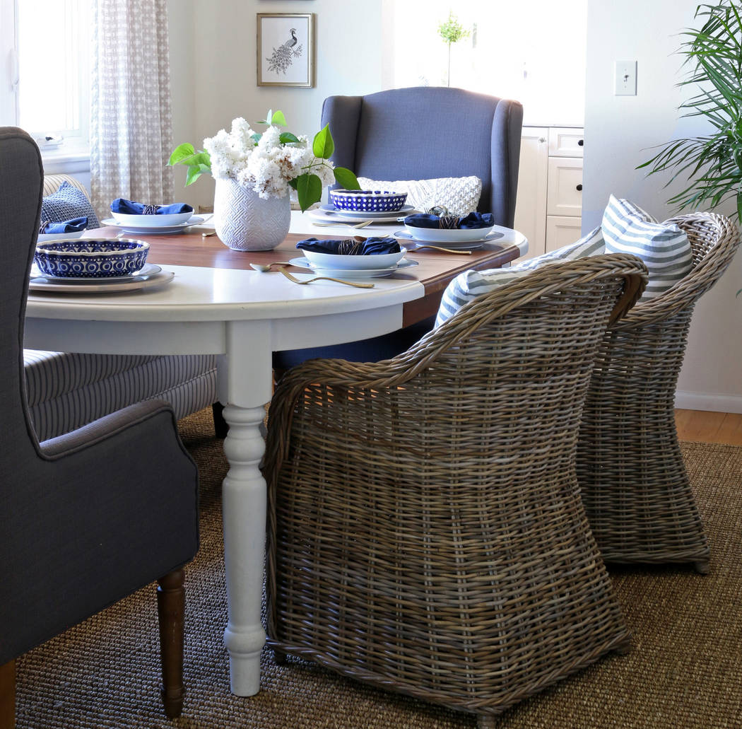 """Pure Publicity Rattan chairs share space with more formal upholstered seating at the dining room table of Melissa Michaels, author of """"Simple Decorating: 50 Ways to Inspire Your Home."""""""