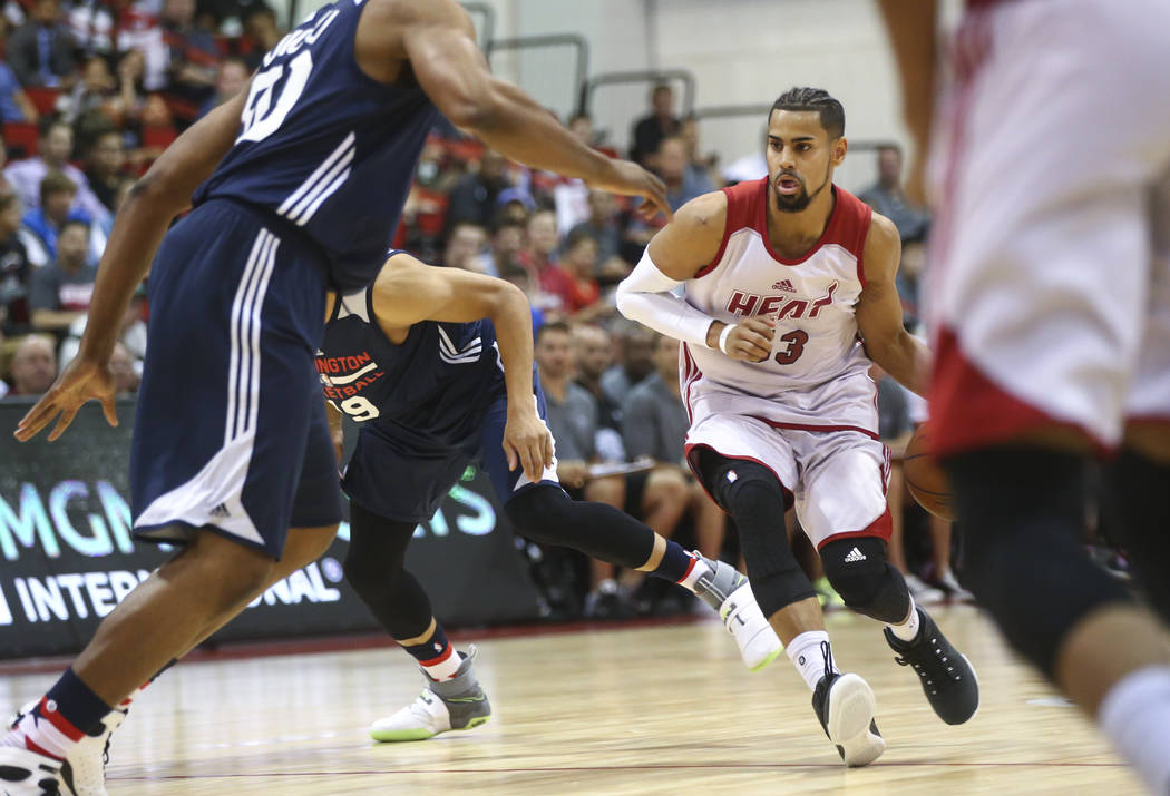 Miami Heat's Gian Clavell (53) drives to the basket against the Washington Wizards during a game at the NBA Summer League in Las Vegas (Chase Stevens Las Vegas Review-Journal)
