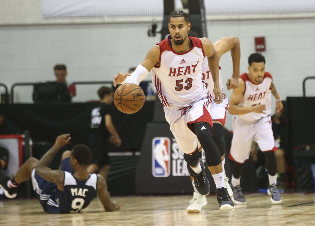 Miami Heat's Gian Clavell (53) brings the ball up court during a basketball game against the Washington Wizards at the NBA Summer League at the Cox Pavilion in Las Vegas on Wednesday, July 12, 201 ...