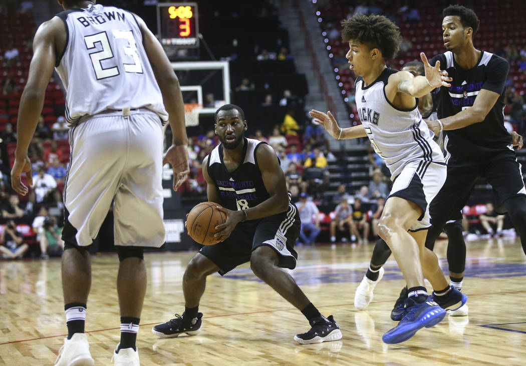 Sacramento Kings' Dominique Hawkins (18) drives to the basket as Milwaukee Bucks' D.J. Wilson (5) defends during a basketball game at the NBA Summer League at the Thomas & Mack Center in Las V ...
