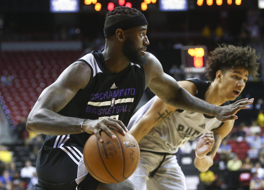 Sacramento Kings' JaKarr Sampson (29) drives to the basket against Milwaukee Bucks' D.J. Wilson (5) during a basketball game at the NBA Summer League at the Thomas & Mack Center in Las Vegas o ...