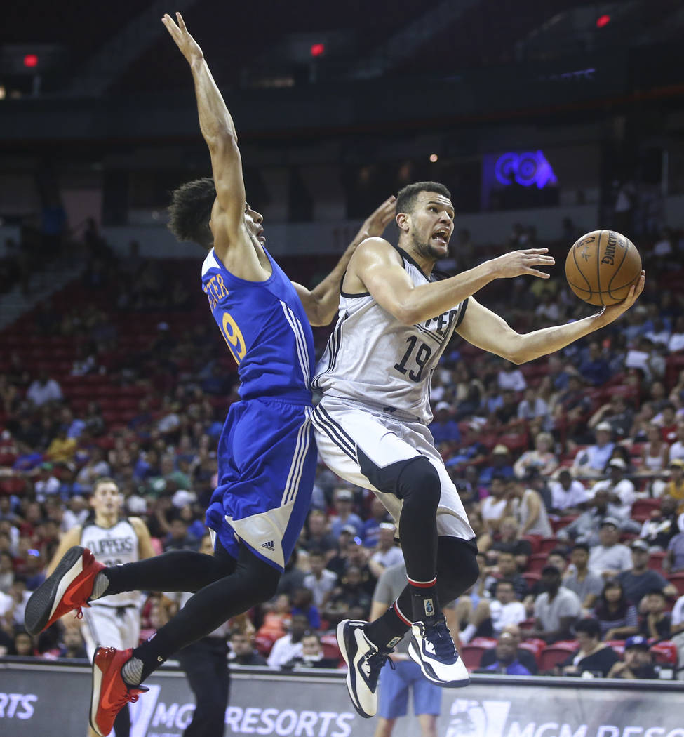 Los Angeles Clippers' Luke Nelson, right, goes to the basket as Golden State Warriors' Tai Webster defends during a basketball game at the NBA Summer League at the Thomas & Mack Center in Las  ...
