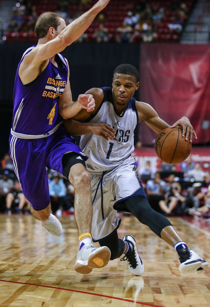 Dallas Mavericks guard Dennis Smith Jr. (1) keeps a ball away from Los Angeles Lakers guard Alex Caruso during the NBA Summer League semifinal game at Thomas and Mack Center on Sunday, July 16, 20 ...