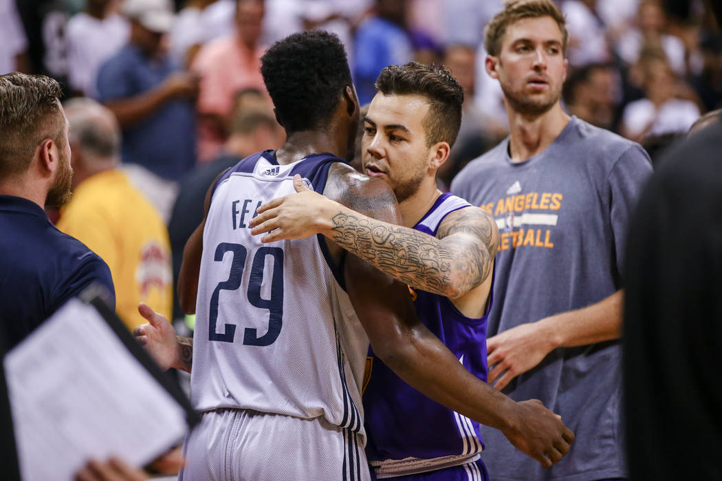Dallas Mavericks forward Carrick Felix (29) embraces Los Angeles Lakers guard Gabe York during the NBA Summer League semifinal game at Thomas and Mack Center on Sunday, July 16, 2017, in Las Vegas ...