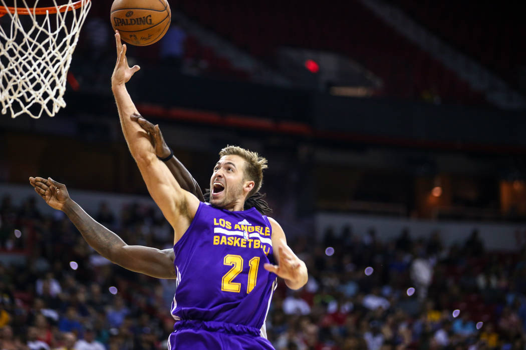 Los Angeles Lakers forward Travis Wear (21) battles for a rebound during the NBA Summer League semifinal game at Thomas and Mack Center on Sunday, July 16, 2017, in Las Vegas.