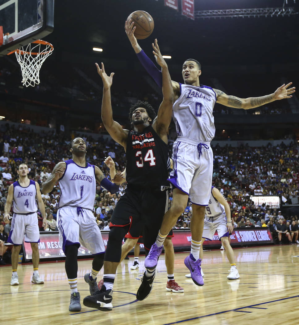 Los Angeles Lakers' Kyle Kuzma (0) gets a rebound over Portland Trail Blazers' Jarnell Stokes (34) during the NBA Summer League championship game at the Thomas & Mack Center in Las Vegas on Mo ...