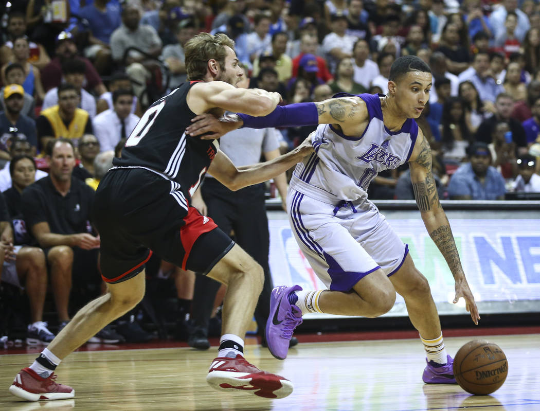 Los Angeles Lakers' Kyle Kuzma (0) drives to the basket against Portland Trail Blazers' Jake Layman (10) during the NBA Summer League championship game at the Thomas & Mack Center in Las Vegas ...
