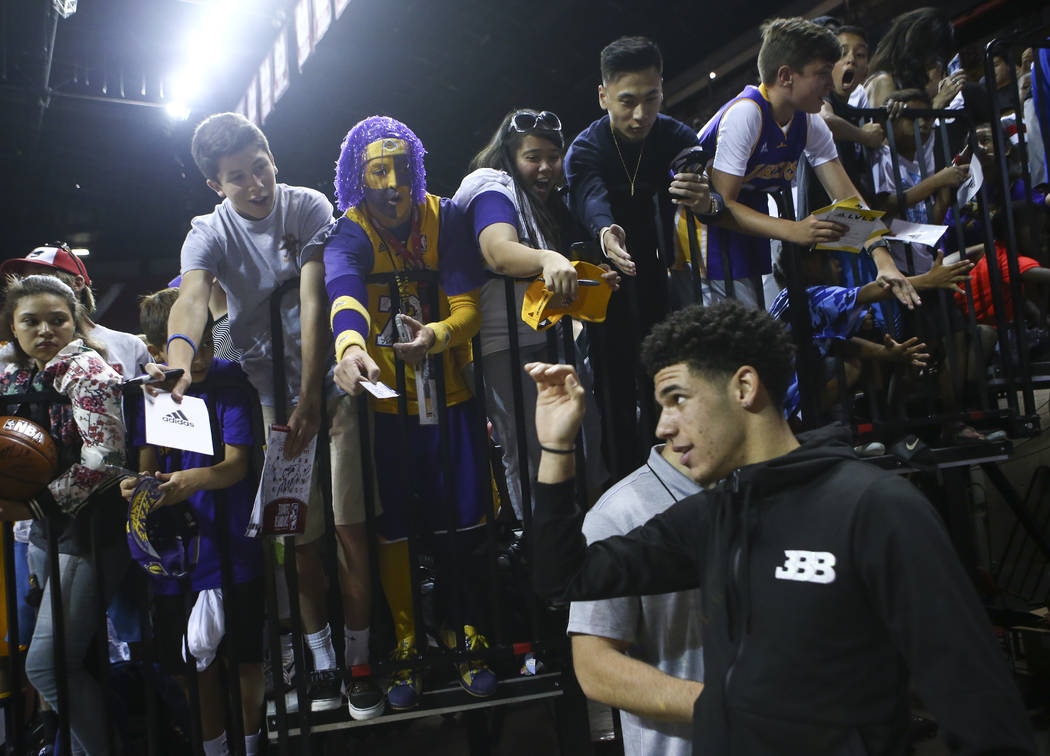 Los Angeles Lakers' Lonzo Ball greets fans before the NBA Summer League championship game at the Thomas & Mack Center in Las Vegas on Monday, July 17, 2017. Chase Stevens Las Vegas Review-Jour ...