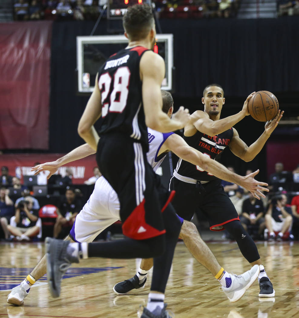 Portland Trail Blazers' Nick Johnson (31) looks to pass to Portland Trail Blazers' RJ Hunter (28) during the NBA Summer League championship game against the Portland Trail Blazers at the Thomas &a ...