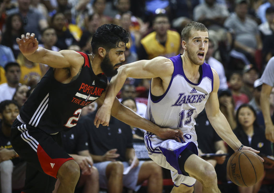 Los Angeles Lakers' Matt Thomas (19) drives against Portland Trail Blazers' Jorge Gutierrez (2) during the NBA Summer League championship game at the Thomas & Mack Center in Las Vegas on Monda ...