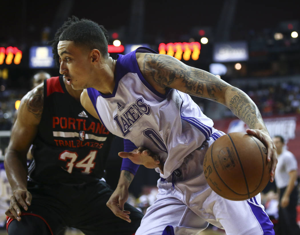 Los Angeles Lakers' Kyle Kuzma (0) drives to the basket against Portland Trail Blazers' DeAndre Daniels (24) during the NBA Summer League championship game at the Thomas & Mack Center in Las V ...