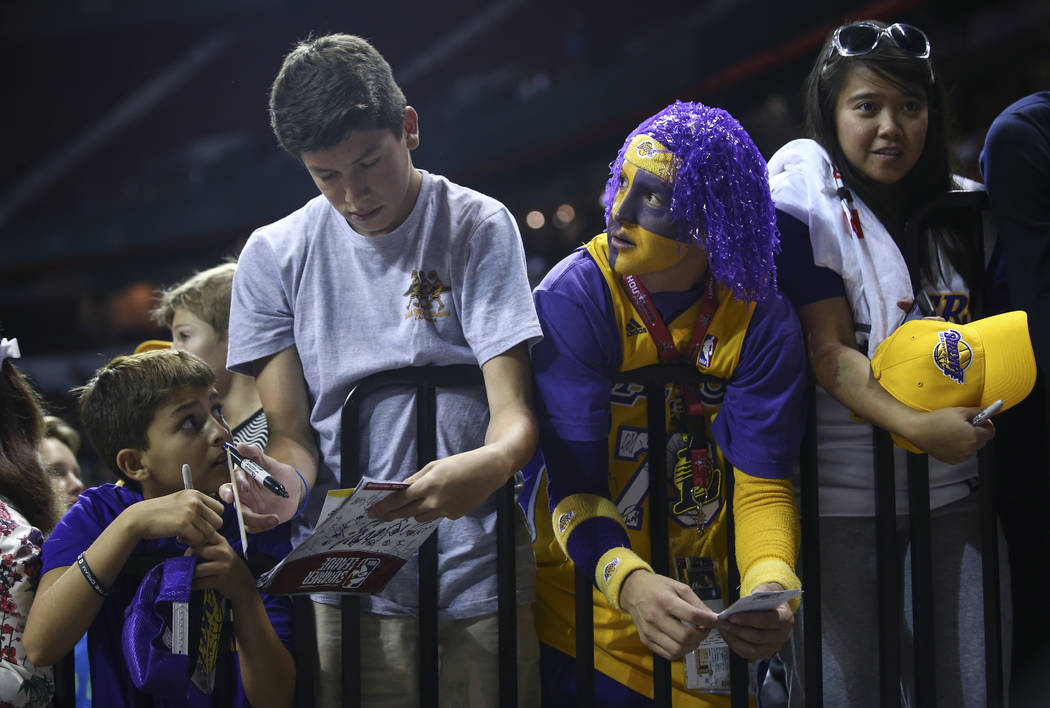 Los Angeles Lakers fans wait for the team to enter the arena for the NBA Summer League championship game at the Thomas & Mack Center in Las Vegas on Monday, July 17, 2017. Chase Stevens Las Ve ...