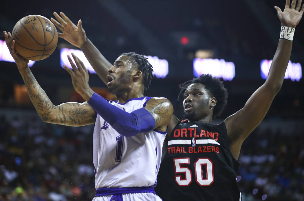 Los Angeles Lakers' Vander Blue (1) goes to the basket as Portland Trail Blazers' Caleb Swanigan (50) defends during the NBA Summer League championship game at the Thomas & Mack Center in Las  ...