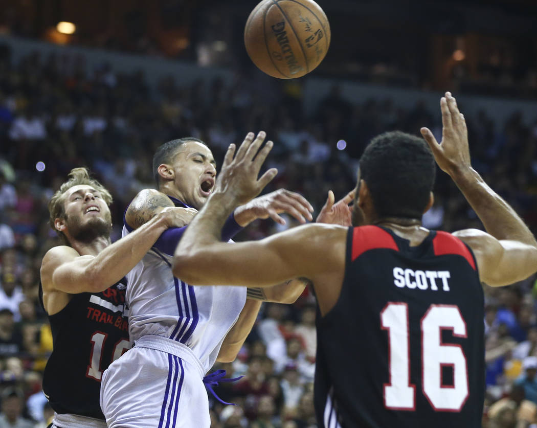 Los Angeles Lakers' Kyle Kuzma (0) is fouled by Portland Trail Blazers' Jake Layman (10) during the NBA Summer League championship game at the Thomas & Mack Center in Las Vegas on Monday, July ...