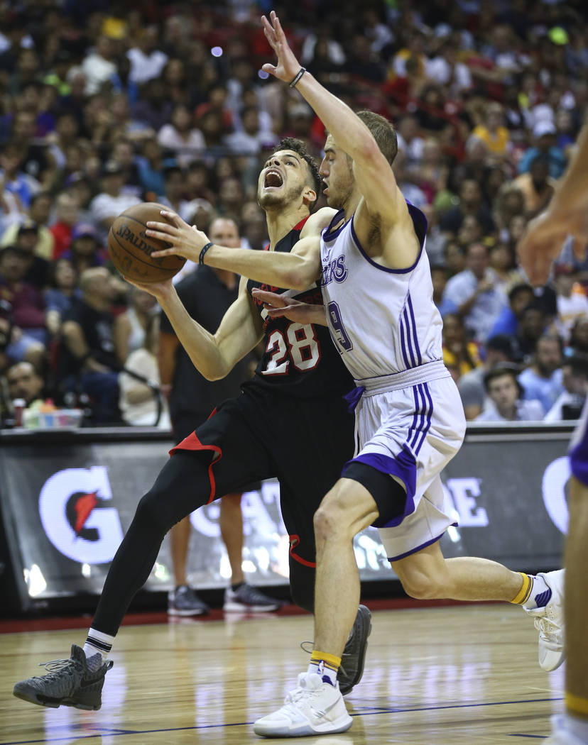 Portland Trail Blazers' RJ Hunter (28) drives to the basket against Los Angeles Lakers' Matt Thomas (19) during the NBA Summer League championship game at the Thomas & Mack Center in Las Vegas ...