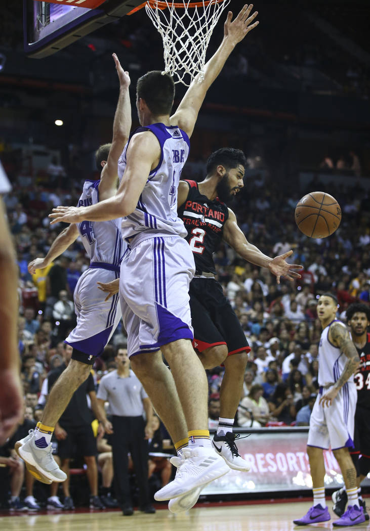 Portland Trail Blazers' Jorge Gutierrez (2) reaches out for a rebound during the NBA Summer League championship game against the Portland Trail Blazers at the Thomas & Mack Center in Las Vegas ...
