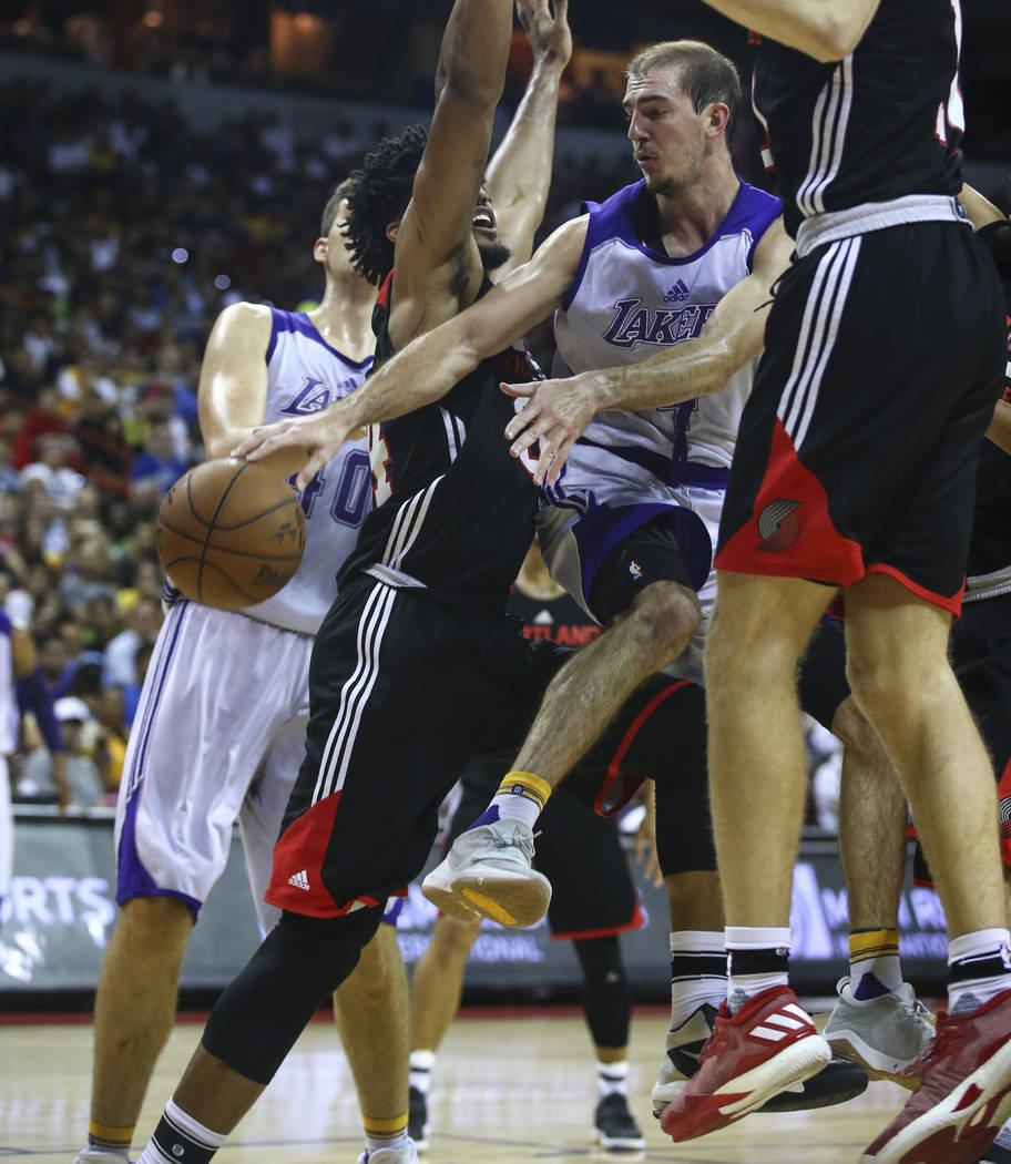 Los Angeles Lakers' Alex Caruso (4) passes the ball through Portland Trail Blazers defenders during the NBA Summer League championship game at the Thomas & Mack Center in Las Vegas on Monday,  ...