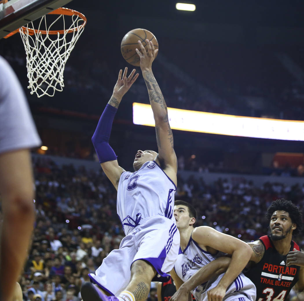 Los Angeles Lakers' Kyle Kuzma (0) sends the ball up against the Portland Trail Blazers during the NBA Summer League championship game at the Thomas & Mack Center in Las Vegas on Monday, July  ...