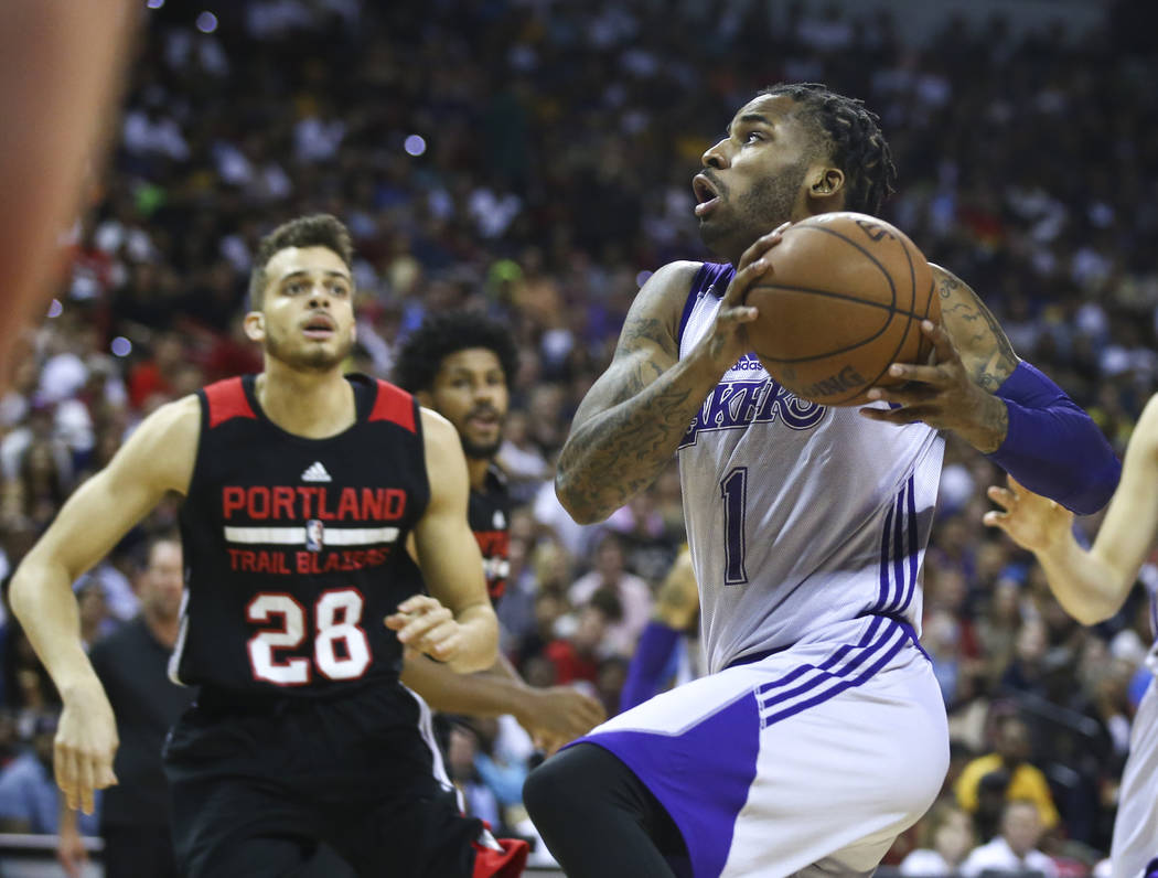 Los Angeles Lakers' Vander Blue (1) drives to the basket past Portland Trail Blazers' RJ Hunter (28) during the NBA Summer League championship game at the Thomas & Mack Center in Las Vegas on  ...