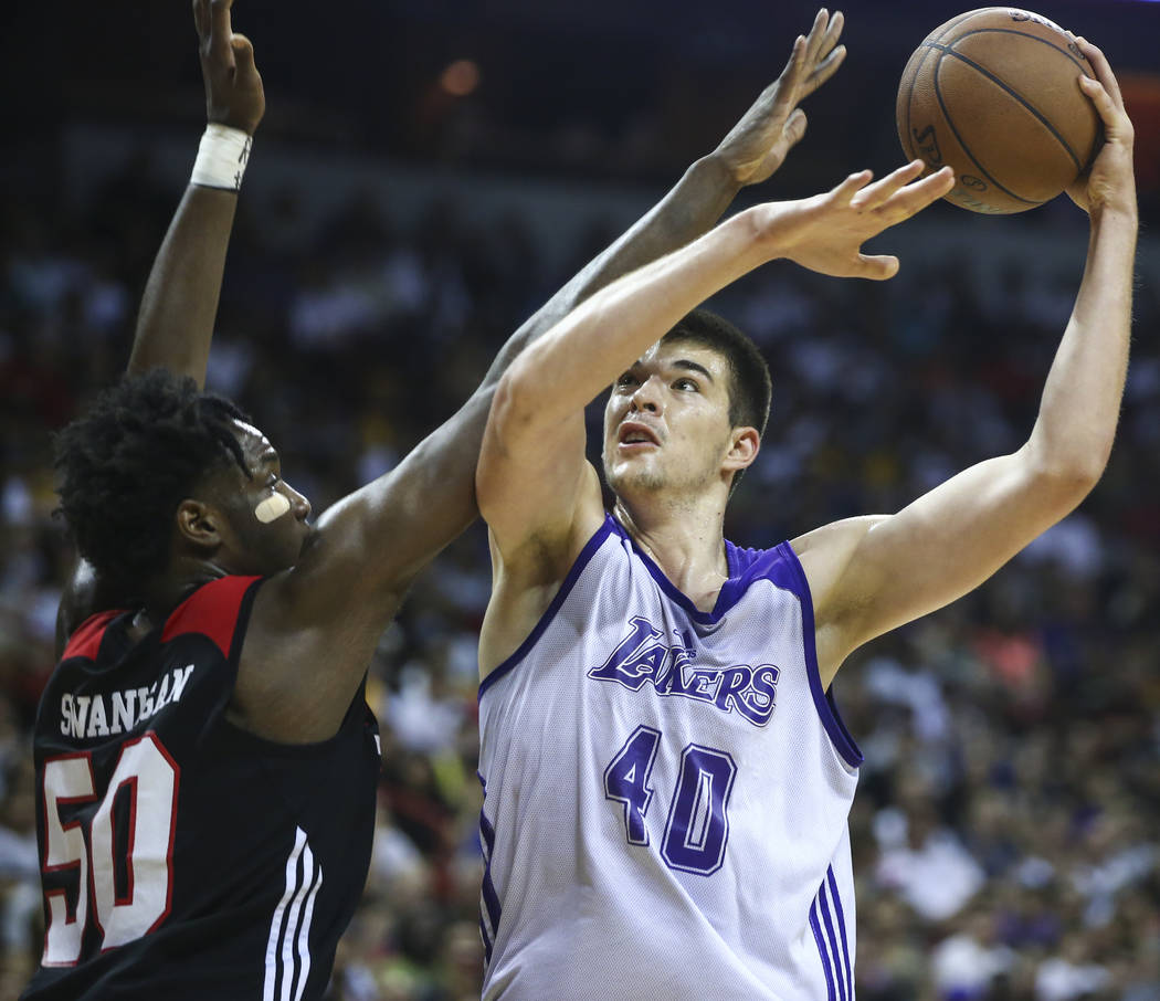 Los Angeles Lakers' Ivica Zubac (40) shoots over Portland Trail Blazers' Caleb Swanigan (50) during the NBA Summer League championship game at the Thomas & Mack Center in Las Vegas on Monday,  ...