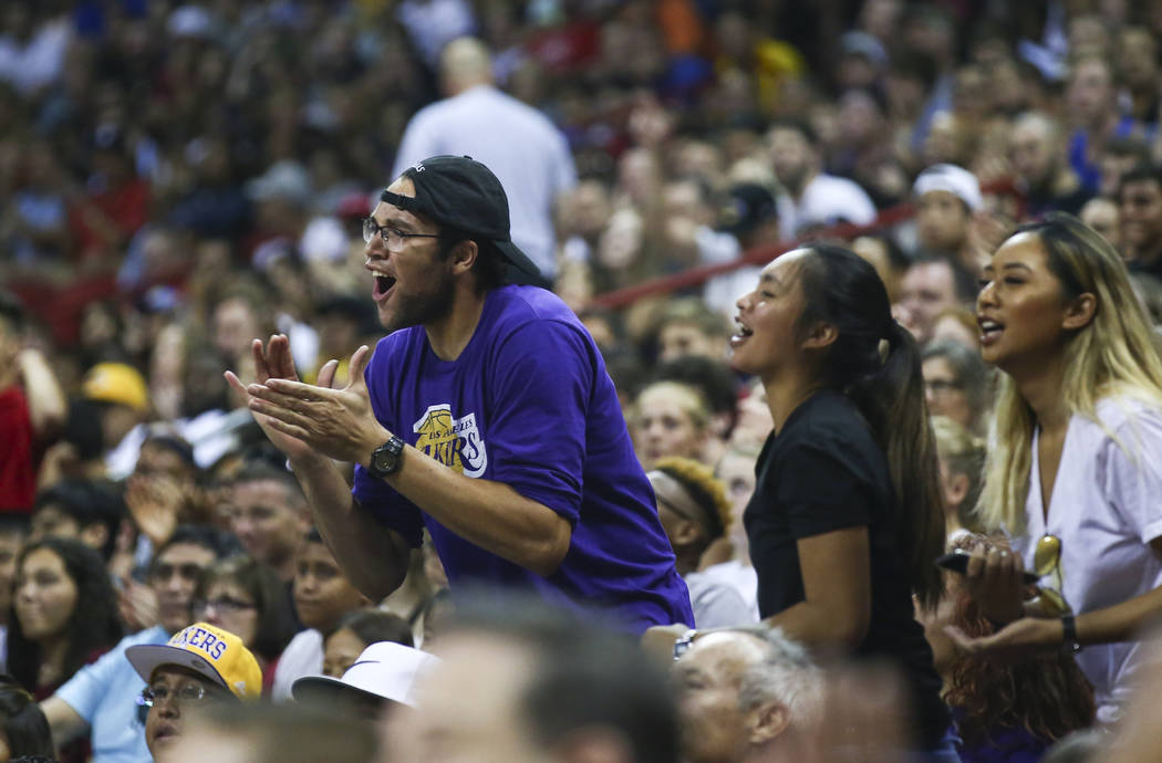 Los Angeles Lakers' fans cheer as their team plays the Portland Trail Blazers during the NBA Summer League championship game at the Thomas & Mack Center in Las Vegas on Monday, July 17, 2017.  ...