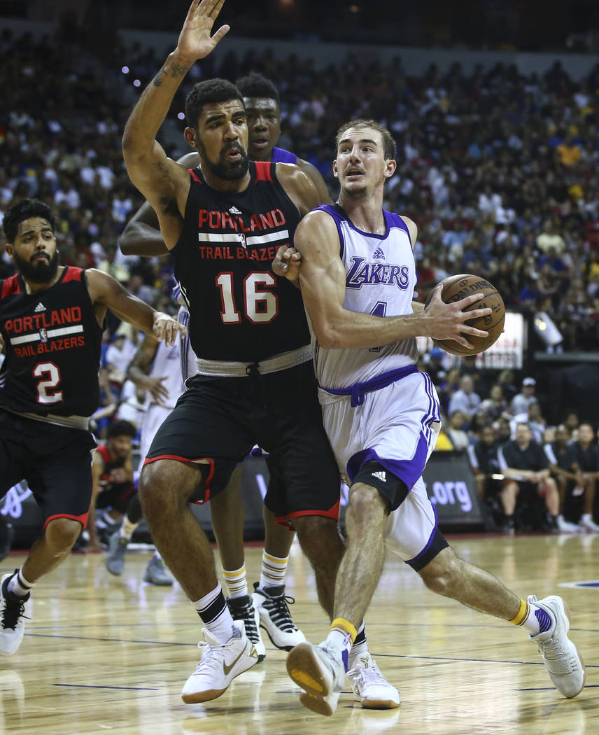 Los Angeles Lakers' Alex Caruso (4) drives to the basket against Portland Trail BlazersՠJosh Scott (16) during the NBA Summer League championship game at the Thomas & Mack Center in Las  ...