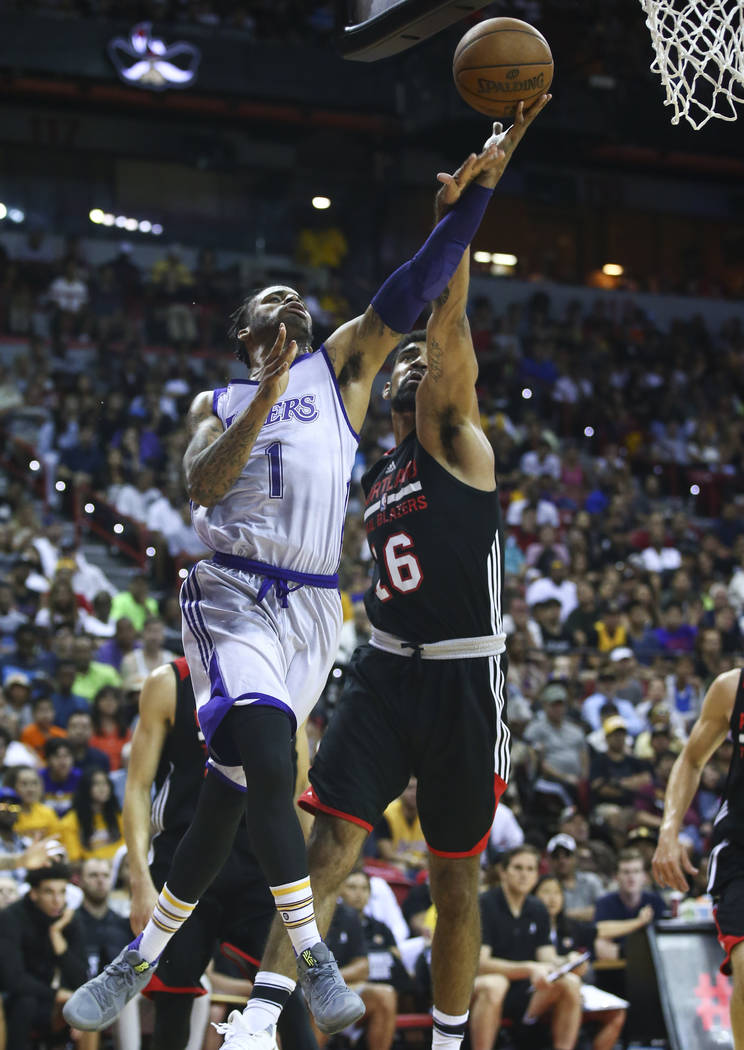 Los Angeles Lakers' Vander Blue (1) goes to the basket against Portland Trail BlazersՠJosh Scott (16) during the NBA Summer League championship game at the Thomas & Mack Center in Las Ve ...