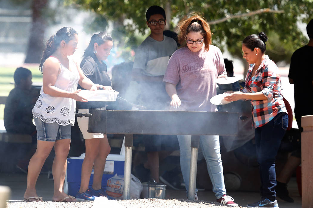 People barbecue at Lorenzi Park during a hot Memorial Day on Monday, May 29, 2017, in Las Vegas. Bizuayehu Tesfaye Las Vegas Review-Journal @bizutesfaye