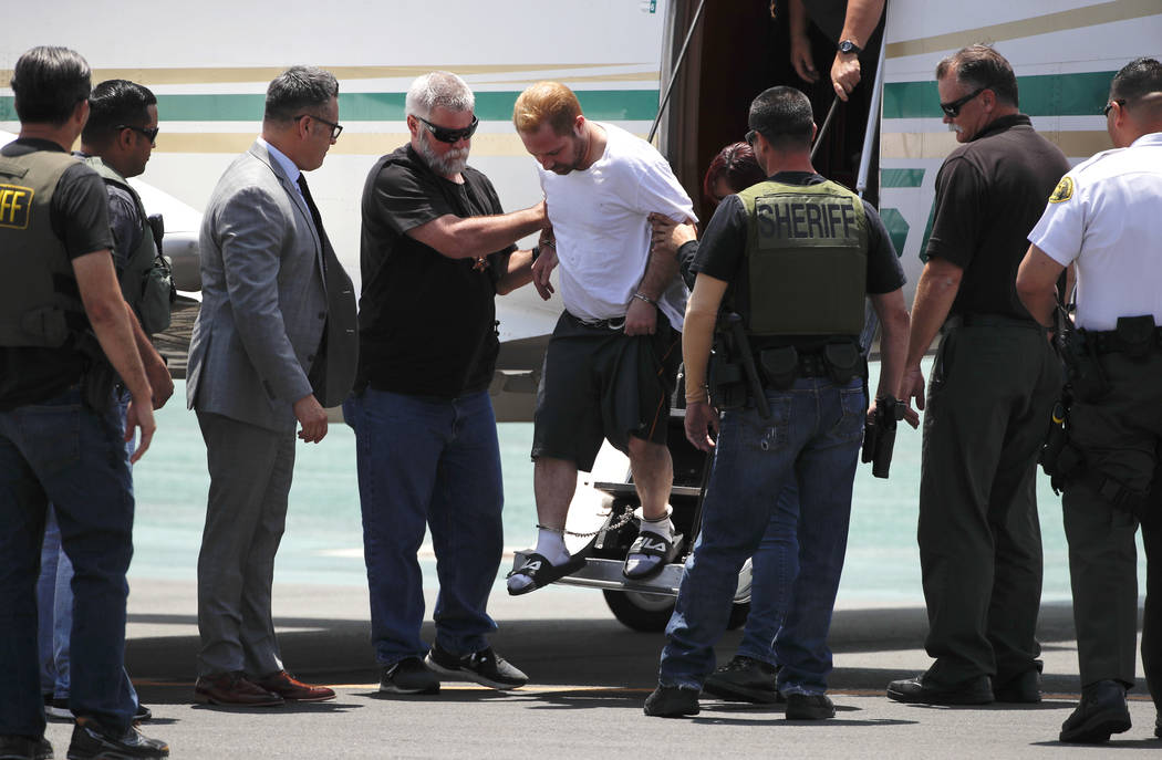 Aramazd Andressian Sr., center, a suspect in killing of his missing 5-year-old son, is escorted off a plane in shackles after landing at the Long Beach Airport, Friday, June 30, 2017, in Long Beac ...
