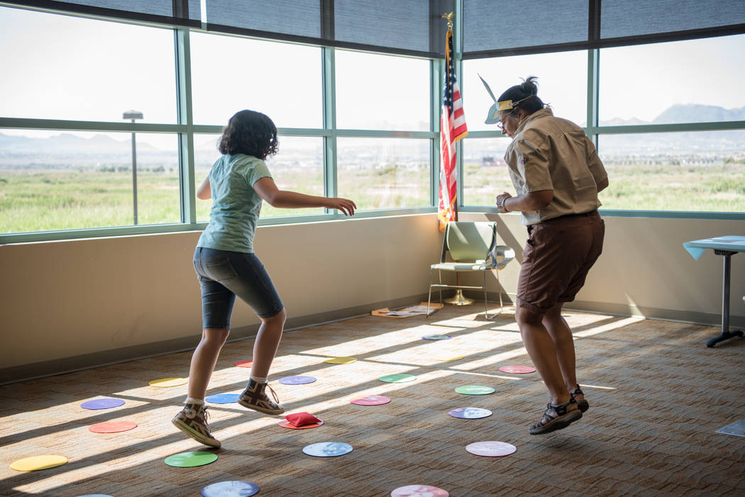 """Athena Morales, left, and Kate Bloomfield, right, play """"the cottontail challenge"""" at Clark County Wetlands Park's annual Summer Open House on Saturday, July 1, 2017, in Las Vegas ..."""
