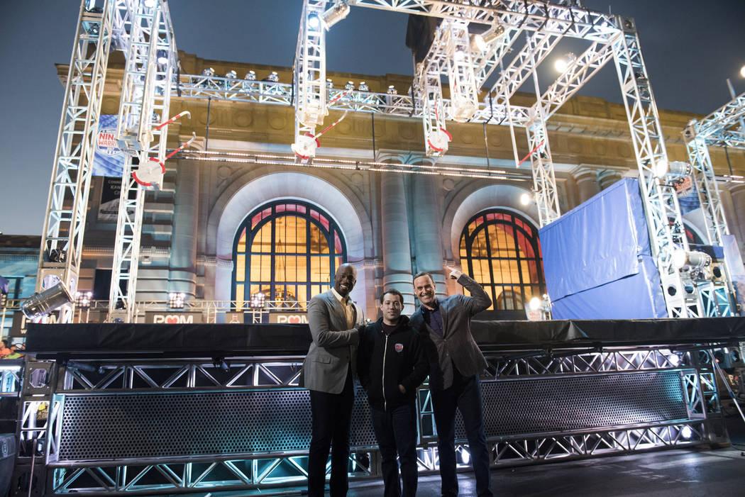 Kevin Brekke  (center) with hosts Matt Iseman and Akbar Gbajabiamila) Credit: Eddy Chen/NBC