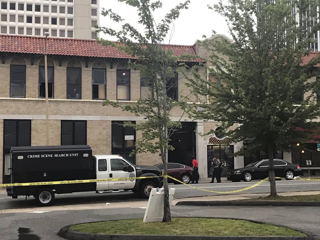 Crime-scene technicians investigate a shooting at an Arkansas nightclub Saturday, July 1, 2017, in Little Rock, Ark. (Andrew DeMillo/AP)