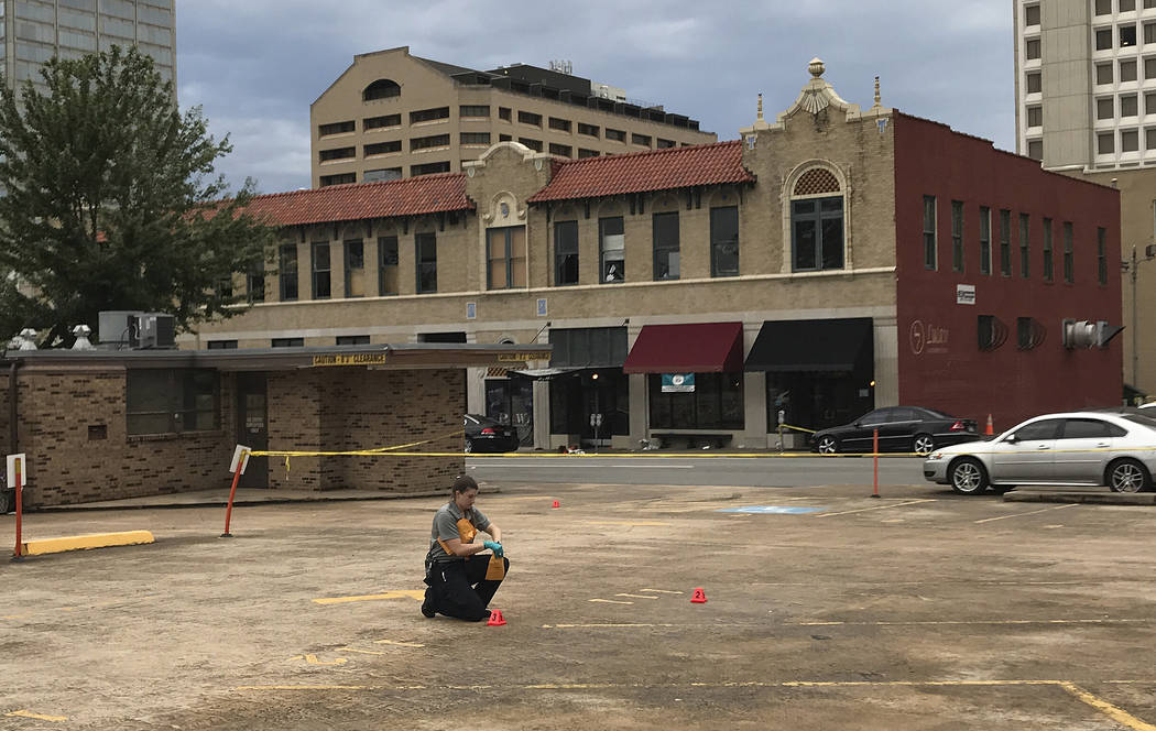 An investigator collects evidence near an Arkansas nightclub where police say multiple people were shot, Saturday, July 1, 2017, in Little Rock, Ark. (Andrew DeMillo/AP)