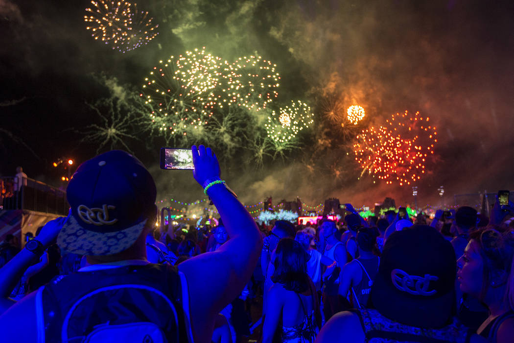 Attendees watch fireworks from  Kinetic Field on the second night of Electric Daisy Carnival at Las Vegas Motor Speedway on Sunday, June 18, 2017 in Las Vegas. Bridget Bennett Las Vegas Review-Jou ...