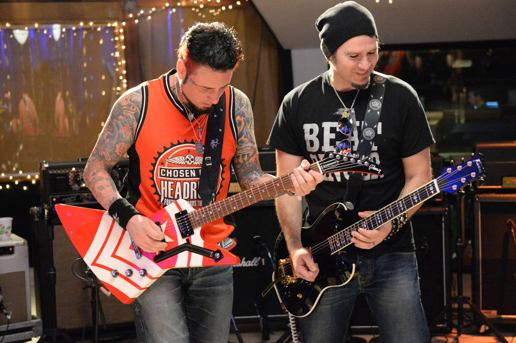 """Jason Hook of Las Vegas rock band Five Finger Death Punch, right, performs with frequent Bon Jovi sideman Phil X. Hook is co-producer of the documentary film """"Hired Gun,"""" which focuses on unsung m ..."""