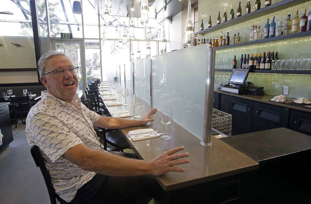 "Joel LaSalle, Current Fish and Oyster owner, sits in front of a partition known as a ""Zion Curtain"" that prevents customers from seeing their alcoholic drinks being mixed and poured, before it's t ..."