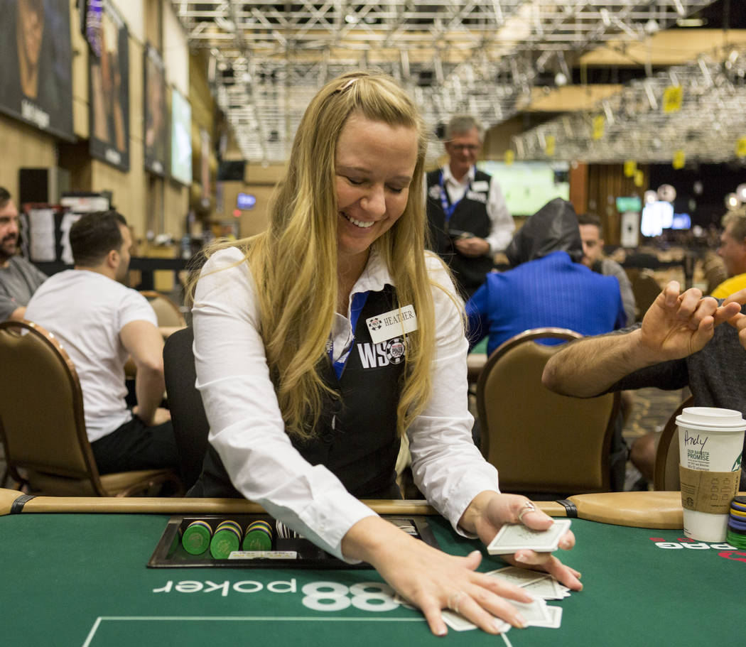 Poker dealer Heather Alcorn deals a game of Pot-Limit Omaha during the 48th annual World Series of Poker at the Rio Convention Center in Las Vegas, Monday, July, 3, 2017. (Elizabeth Brumley/Las Ve ...