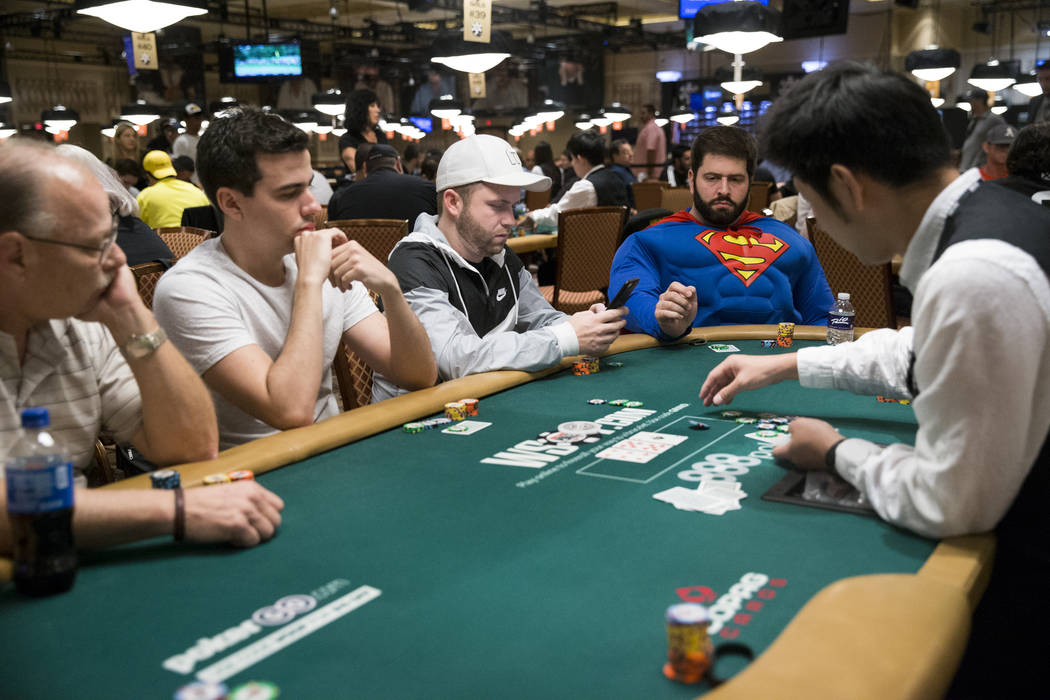 Jonathan Dwek, right, of Toronto, Canada during the World Series of Poker Main Event day 1A at the Rio Convention Center in Las Vegas, Saturday, July 8, 2017. Erik Verduzco Las Vegas Review-Journa ...