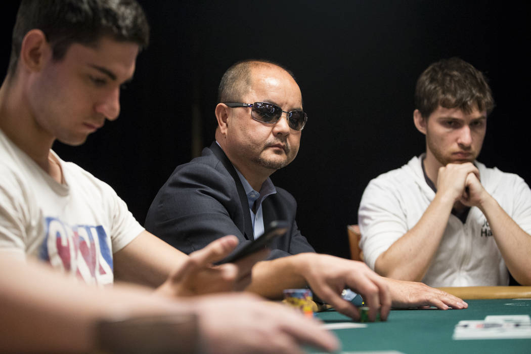 Jerry Yang, center, 2007 World Series of Poker Main Event champion, during the World Series of Poker Main Event day 1A at the Rio Convention Center in Las Vegas, Saturday, July 8, 2017. Erik Verdu ...
