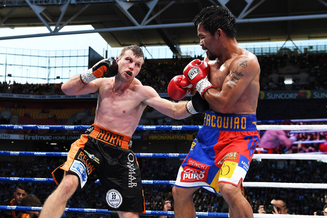 Manny Pacquiao of the Philippines and Jeff Horn of Australia fight.  (AAP/Dan Peled/via Reuters)