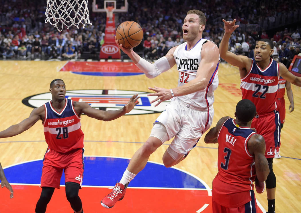 Los Angeles Clippers forward Blake Griffin, second from left, shoots as Washington Wizards center Ian Mahinmi, left, guard Bradley Beal, second from right, and forward Otto Porter Jr. defend durin ...
