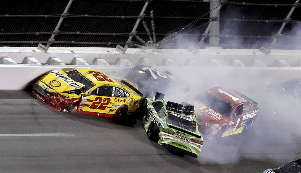 Joey Logano (22), Kyle Busch (18), Jamie McMurray and Martin Truex Jr. (78) get caught up in a wreck in Turn 2 during the NASCAR Cup auto race at Daytona International Speedway, Saturday, July 1,  ...