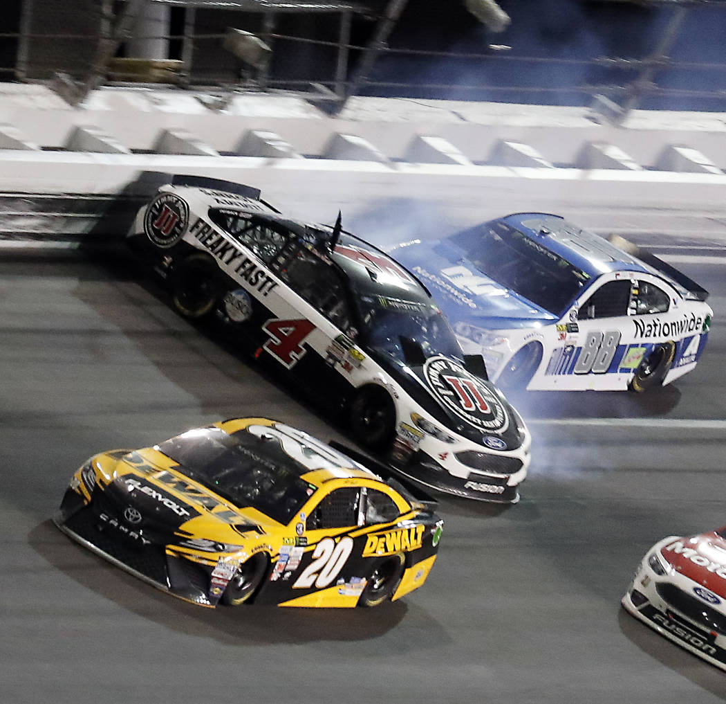 Kevin Harvick (4) is hit by Dale Earnhardt Jr. (88) after he cut a tire as Matt Kenseth (20) avoids the crash during the NASCAR Cup auto race at Daytona International Speedway, Saturday, July 1, 2 ...