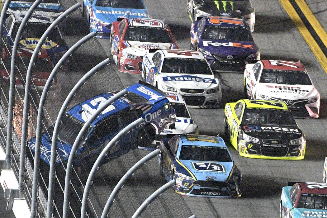 Kyle Larson (42) hits the wall on the front stretch as Ricky Stenhouse Jr. (17) passes underneath during the NASCAR Cup auto race in Daytona Beach, Fla., Saturday, July 1, 2017. (AP Photo/Phelan M ...