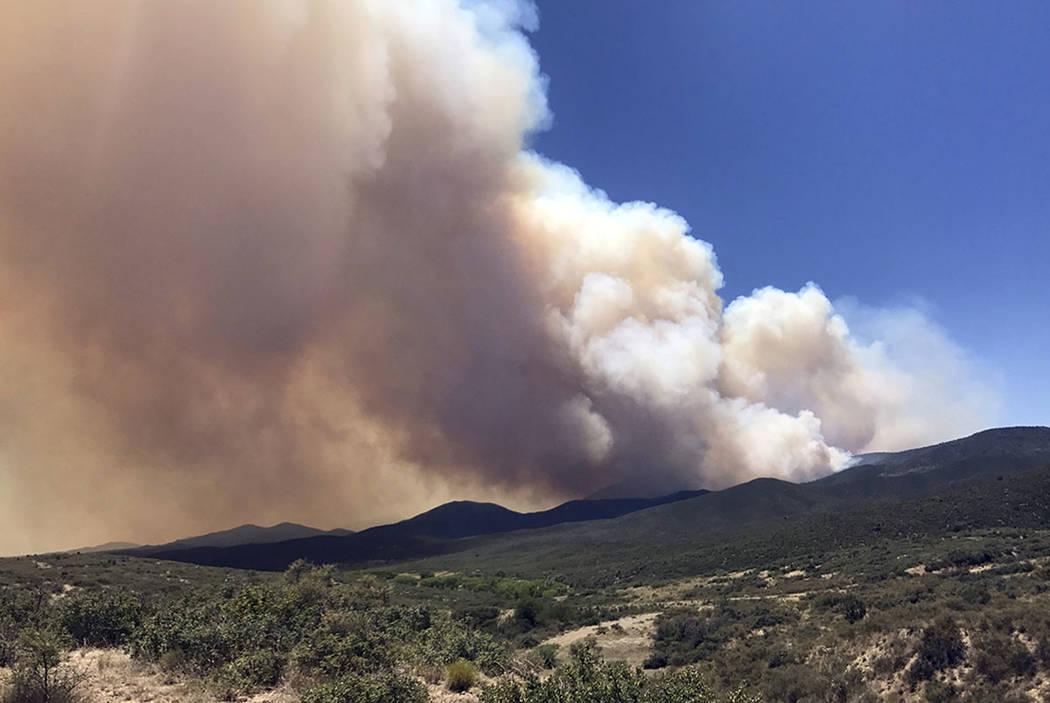 Smoke billows from a wildfire locally called Goodwin Fire, near Prescott, Ariz. (Les Stukenberg/The Daily Courier via AP, File)