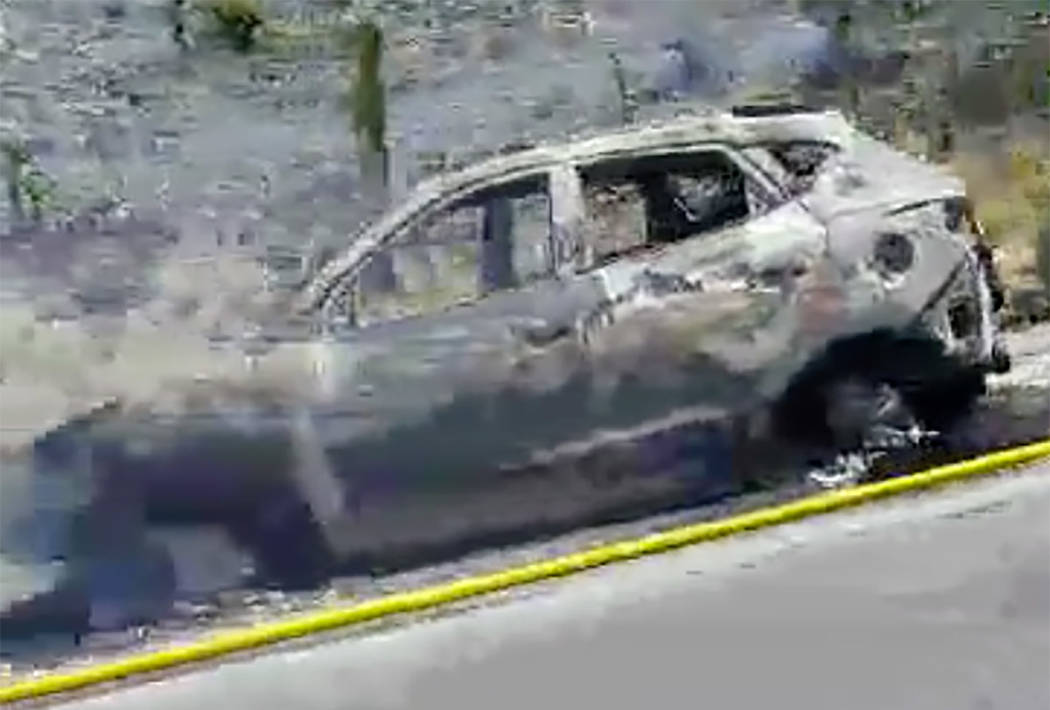 Burned car is seen in the Mountain Pass area on Interstate 15 north in California. (William Michael Rouse/Facebook)
