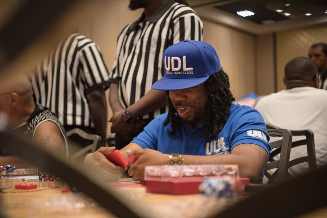 Milwaukee Lee jokes with his opponent at the Summer Slam Domino Tournament hosted by the The Universal Domino League at Westgate hotel-casino on Saturday, July 8, 2017, in Las Vegas. Morgan Lieber ...